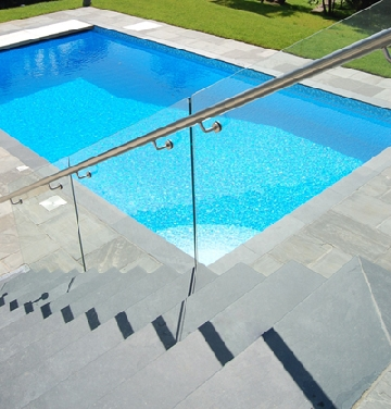 slate steps and tiles by outdoor swimming pool